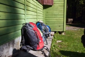 several backpack leaning on a wooden house